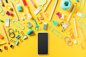 Back to school flat lay on yellow background