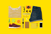 Getting ready for school flat lay, womenswear. Back to school flat lay on yellow background