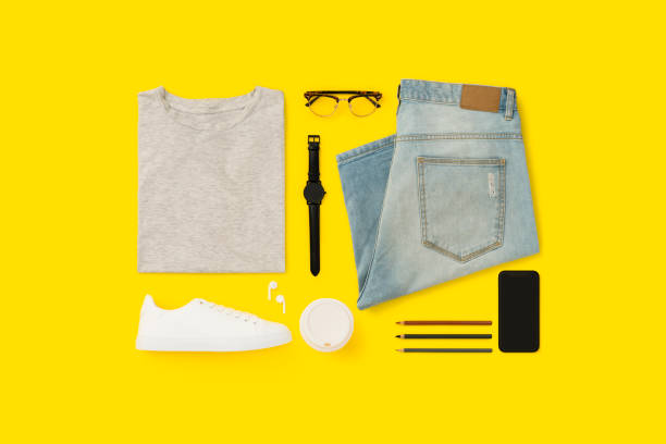 Back to school flat lay on yellow background. Getting ready for school flat lay, menswear. Back to school flat lay on yellow background menswear stock pictures, royalty-free photos & images