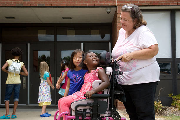 Back to school for little girl in wheelchair stock photo