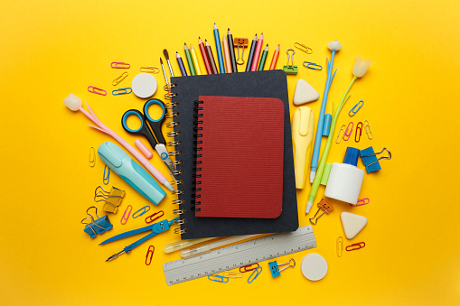 Back to school, items on yellow background. Welcome to learning. Sale accessories for knowledge, retail. Study shopping.
