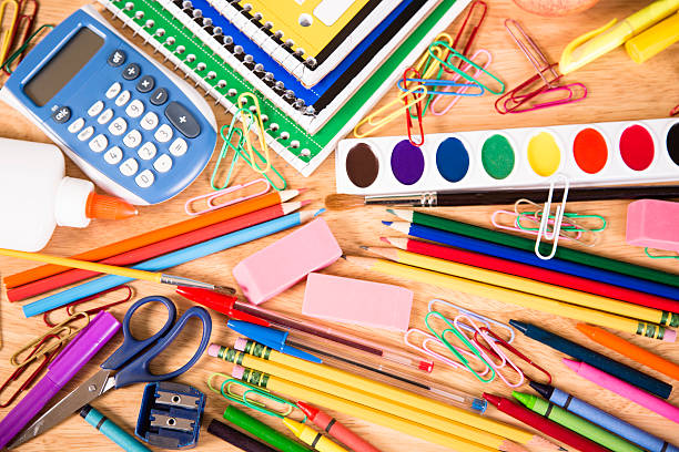 Back to school. Large pile of school supplies on desk. stock photo