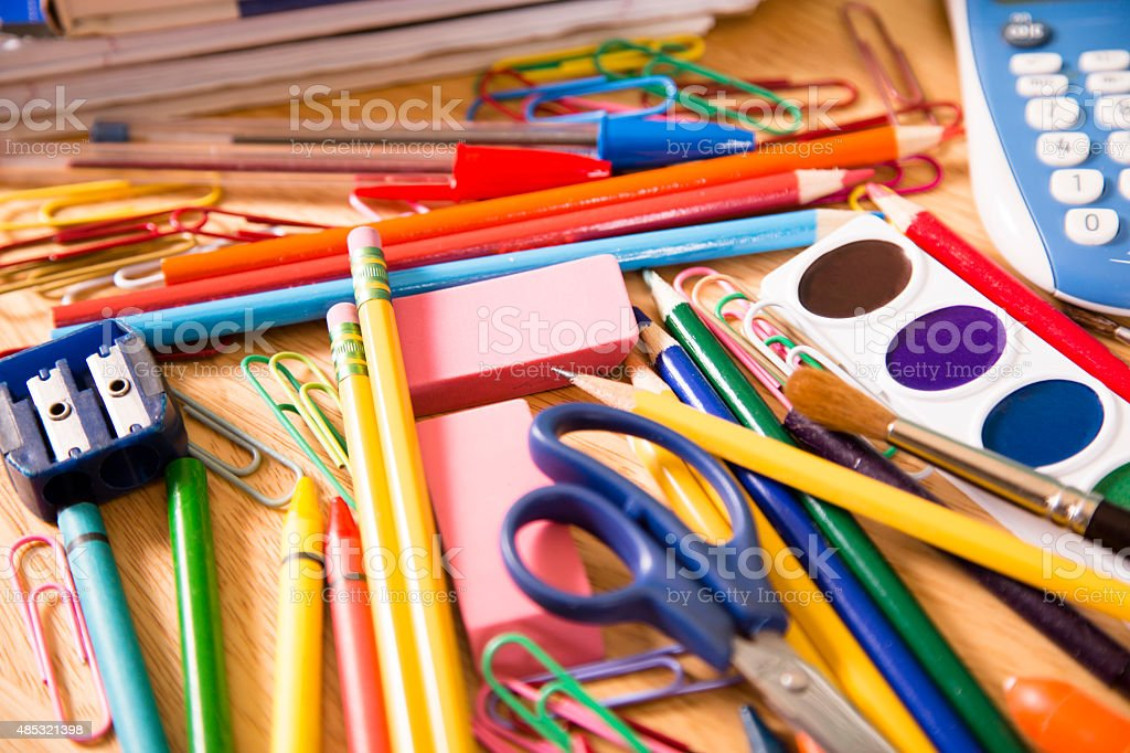 Back to school. Large pile of school supplies. Pencils, crayons. stock photo