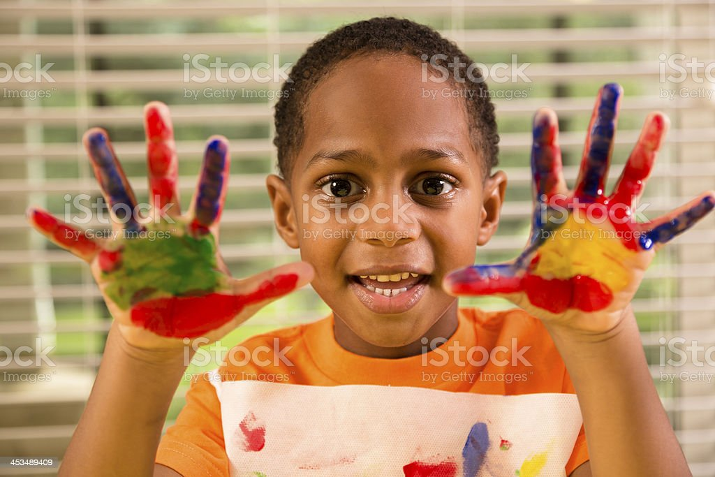 Back to School: Little boy finger painting in art class. royalty-free stock photo