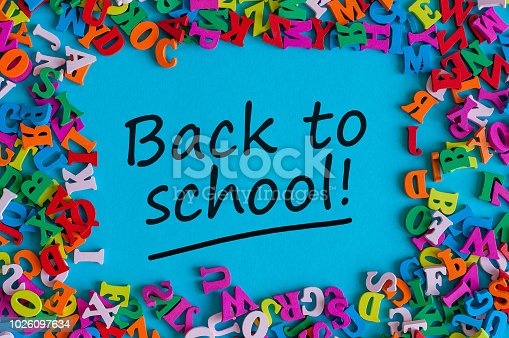 istock Back to school - Message at blue background with many little color letters. Education concept, 1 september time 1026097634