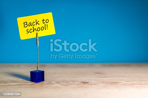 istock Back to school - Message at little nameplate at blue background. Education concept, 1 september time 1026097034