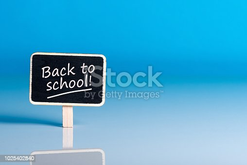 istock Back to school - Message at little plate at blue background. Education concept, 1 september time 1025402840