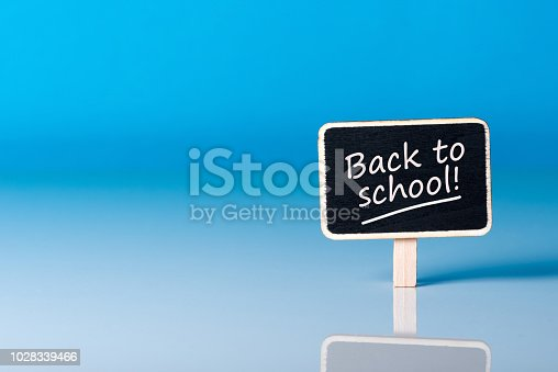 istock Back to school - Message at little plate at blue background. Education concept, 1 september time 1028339466