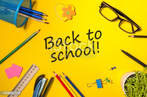 istock Back to school - Message at yellow background with many little color letters and school supplies. Education concept, 1 september time 1026097514