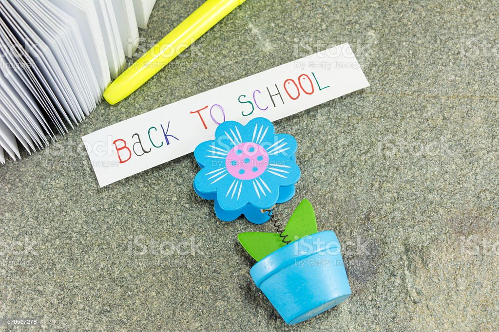 Back to school note in a paper holder stock photo