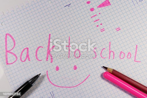 istock Back to school on cubed paper written pink felt-tip pen 1023340164