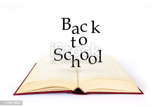 istock Back to school. Open book on white background. Text 1149078837