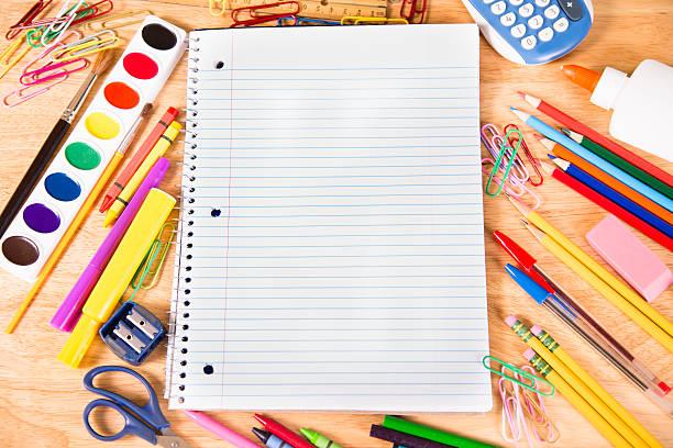 back to school. pile of school supplies with open notebook. - linjerat papper bakgrund bildbanksfoton och bilder