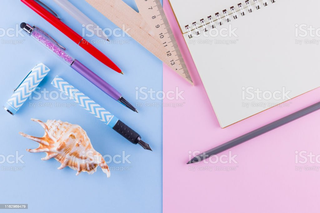Back to school pop art concept. School stationery and seashell on...