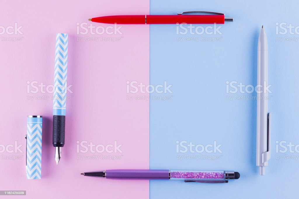 Back to school pop art concept. School stationery on pink blue...