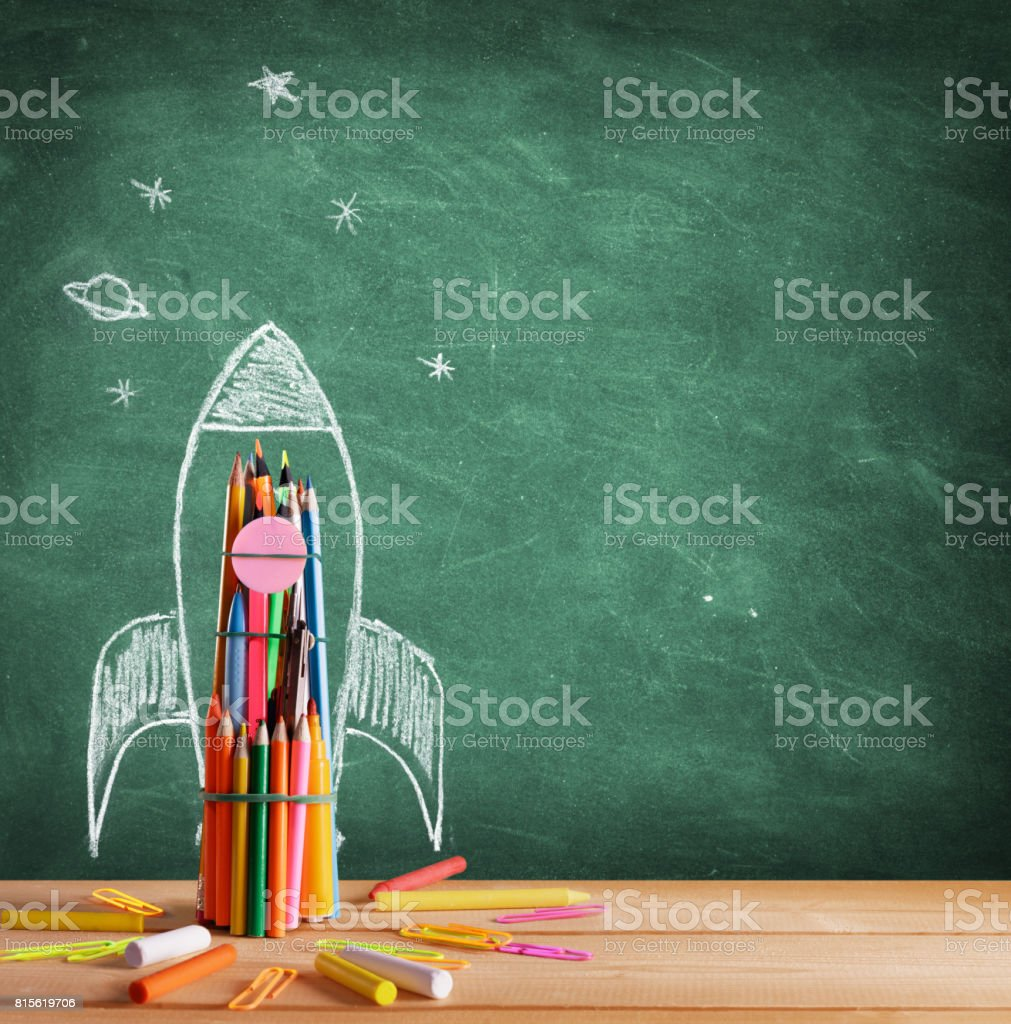 Back To School - Rocket Sketch On Blackboard stock photo