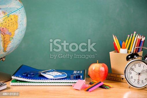 istock Back to school. School supplies, globe, clock on desk. Education. 480131312