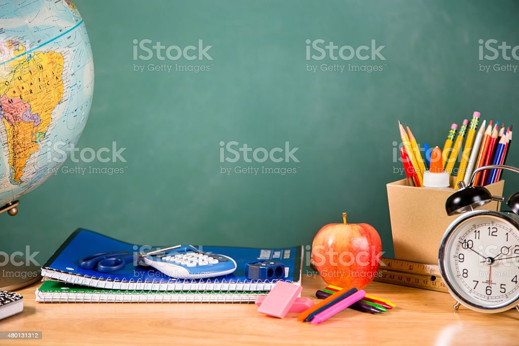 Back to school. School supplies, globe, clock on desk. Education. stock photo
