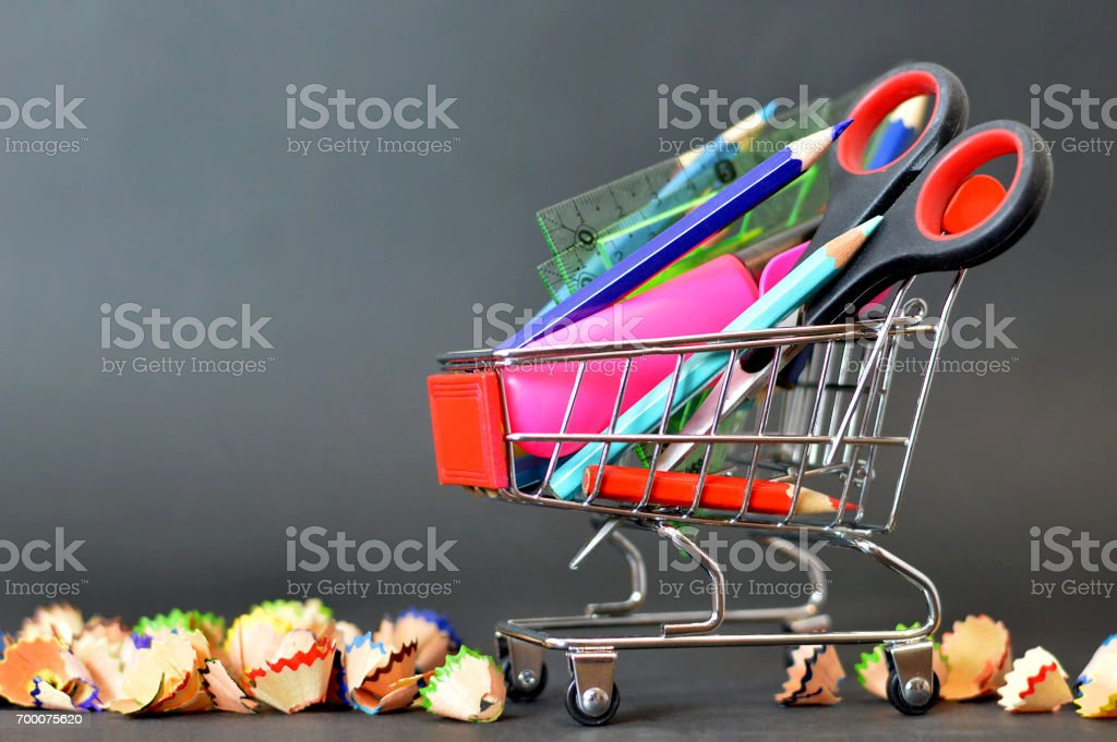 Back to school: School supplies in shopping cart stock photo