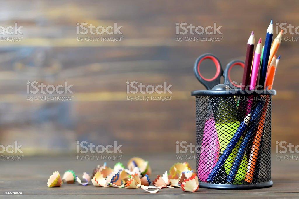 Back to school: School supplies on wooden background