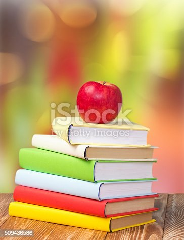 istock Back to school september holiday background stack books apple. 509436586
