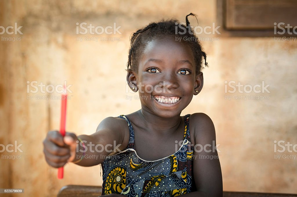 Back To School Symbol - African Girl Toothy Huge Smile stock photo