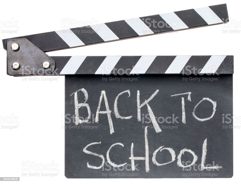 back to school text on clapboard stock photo