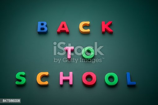 istock Back to school text write with wooden alphabet in blackboard. 847586008