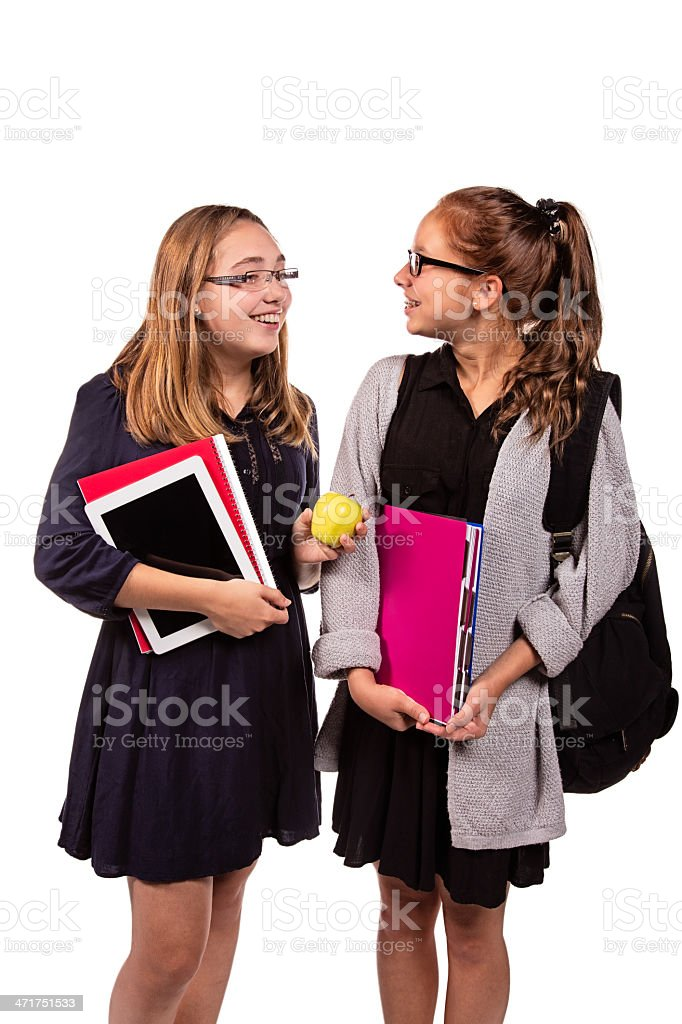 Back to School: Two teenage girls chatting cheerfully royalty-free stock photo