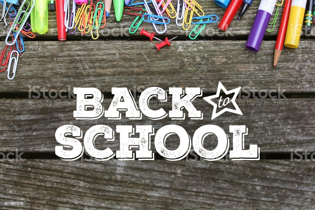 Back to School Typography on Wood Background with School Supplies stock photo