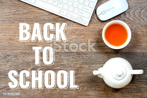 istock back to school - white text over gray table 1018282382