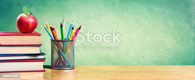 istock Back To School With Apple On Books And Colorful pencils 588609682
