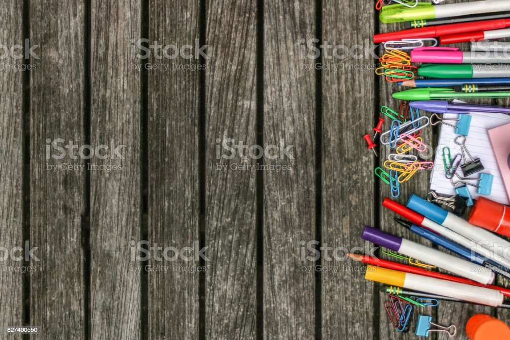 Back to School Wood Background with Colorful School Supplies stock photo