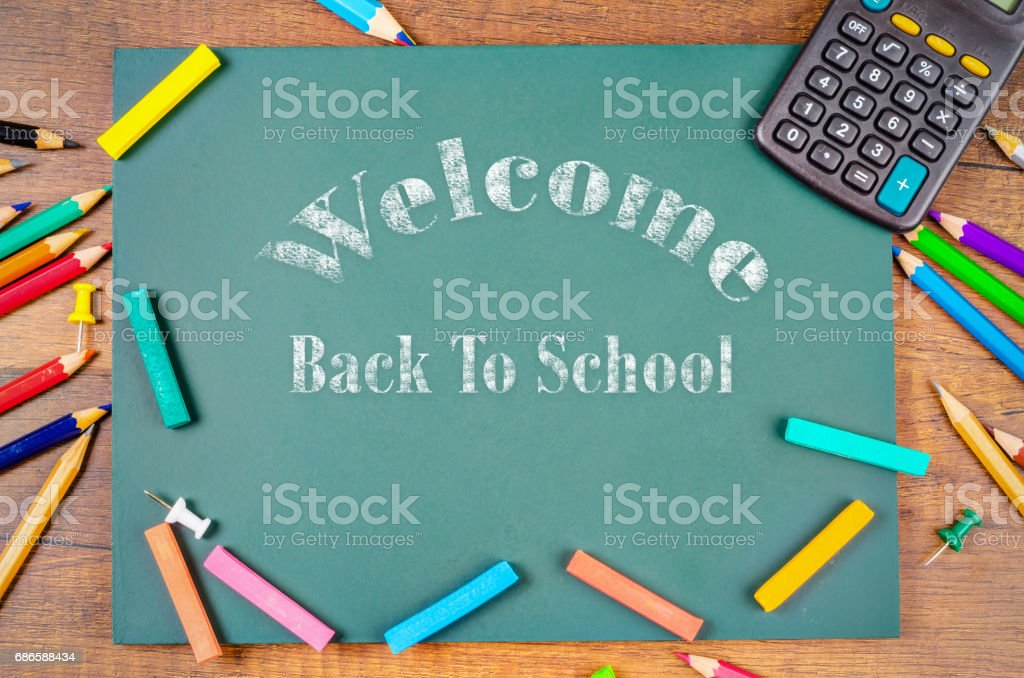 Back to school word with School supplies on green board royalty-free stock photo