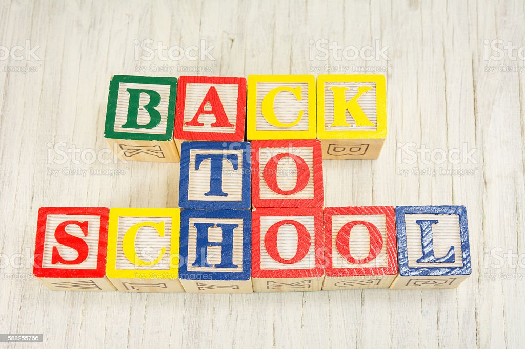 Back to school written in wooden cubicle letters stock photo