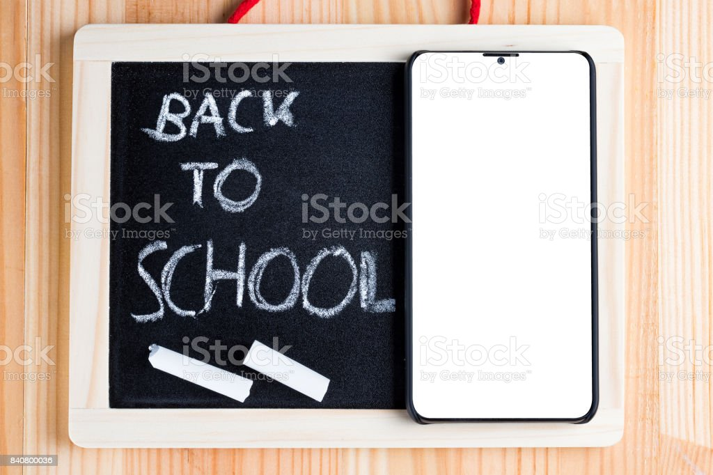 Back to school written on a blackboard. stock photo