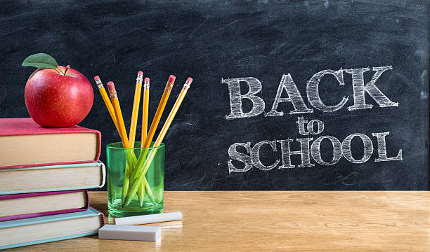 back to school - written on blackboard with book - back to school stock photos and pictures