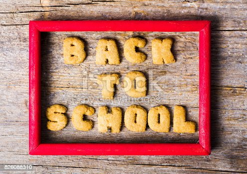 istock Back to school written with cookies on wooden table 826088310