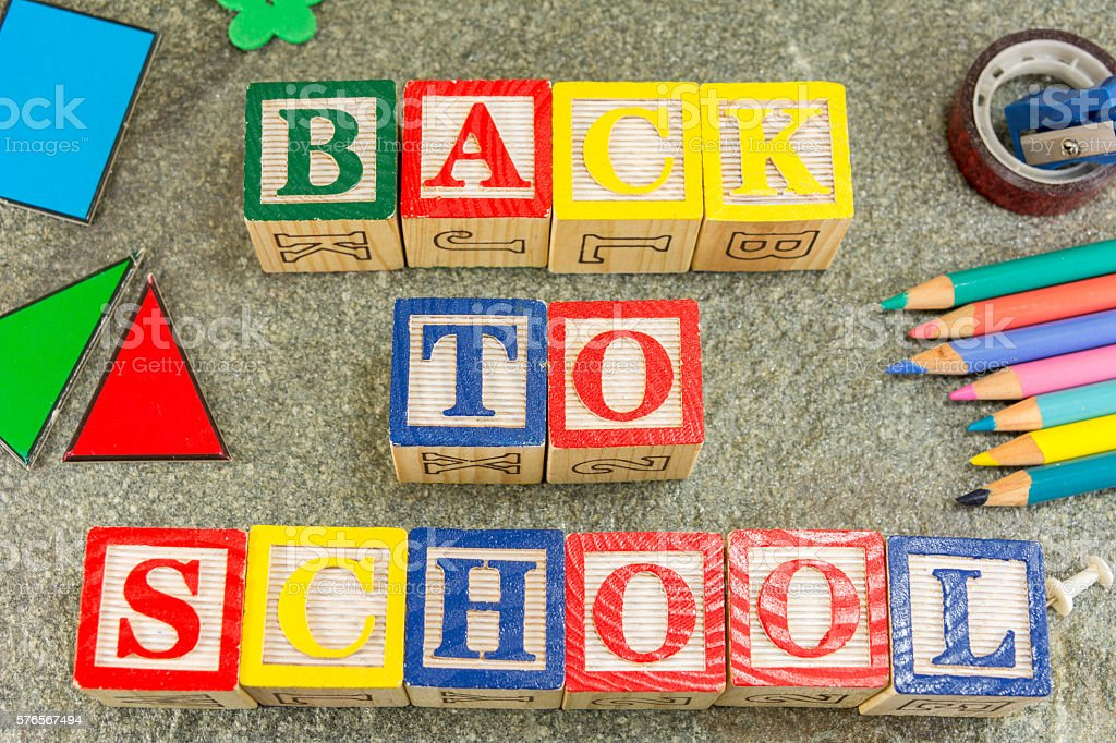 Back to school written with wooden cubical letters stock photo