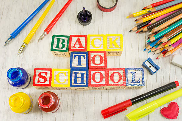 Back to school written with wooden cubicle letters - foto de acervo