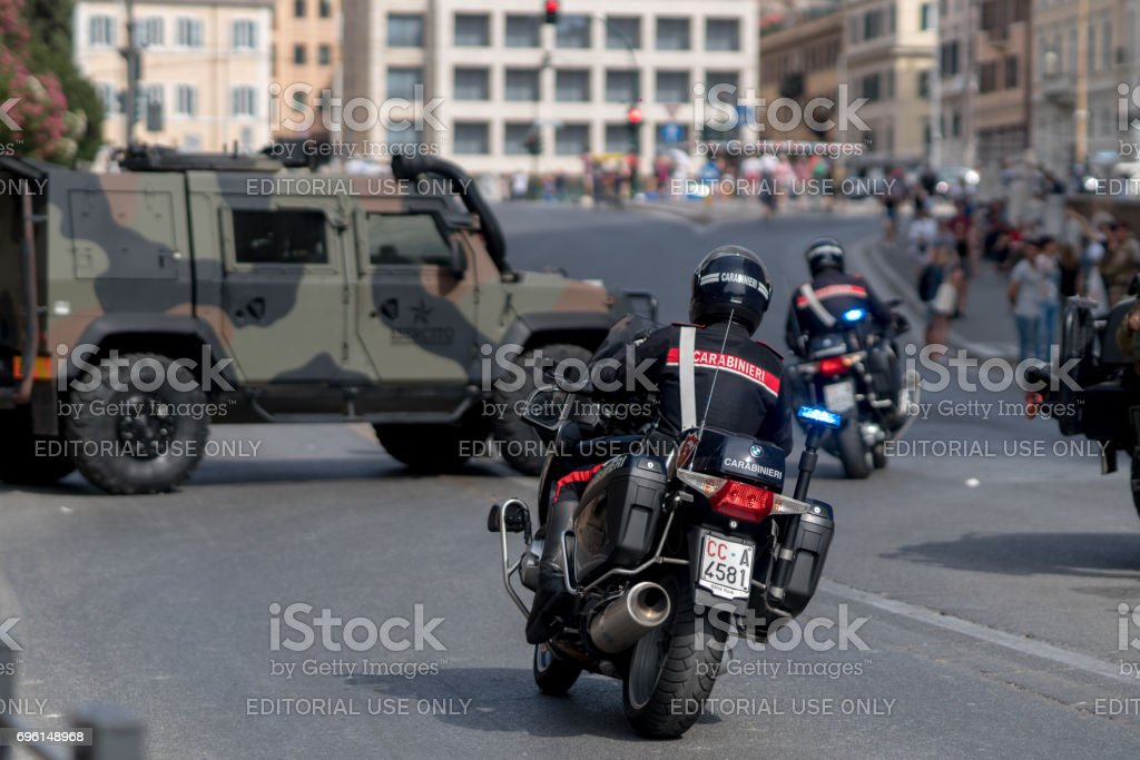 Back turned Italian carabinieri on motorcycles stock photo