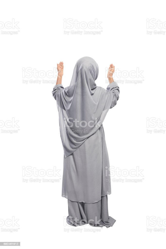 Back view asian muslim girl raising hand and praying 免版稅 stock photo