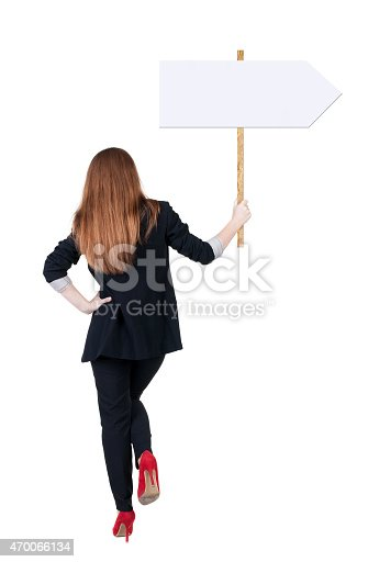 istock Back view business woman showing sign board. 470066134