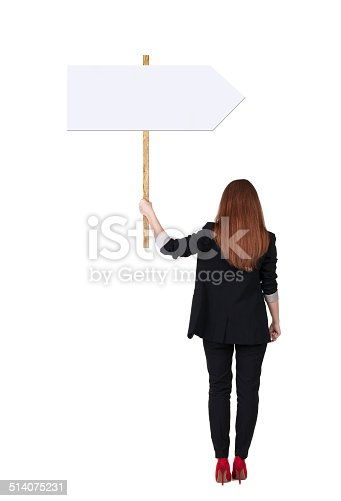 istock Back view business woman showing sign board. 514075231