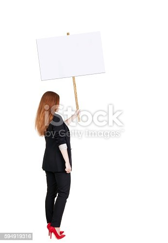istock Back view business woman showing sign board. 594919316