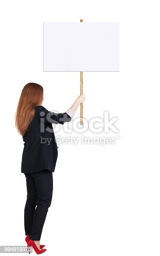 istock Back view business woman showing sign board. 594919370