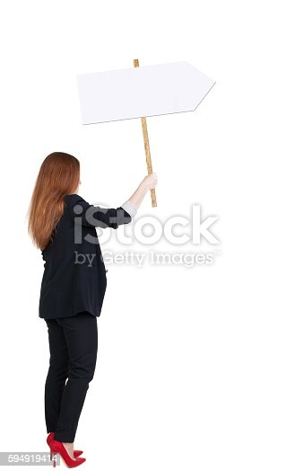istock Back view business woman showing sign board. 594919414