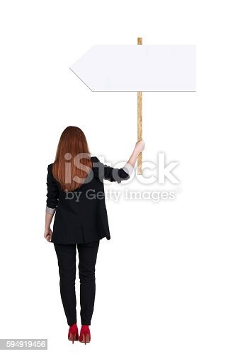 istock Back view business woman showing sign board. 594919456
