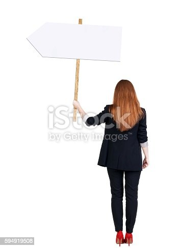 istock Back view business woman showing sign board. 594919508