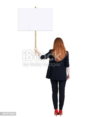 istock Back view business woman showing sign board. 594919550